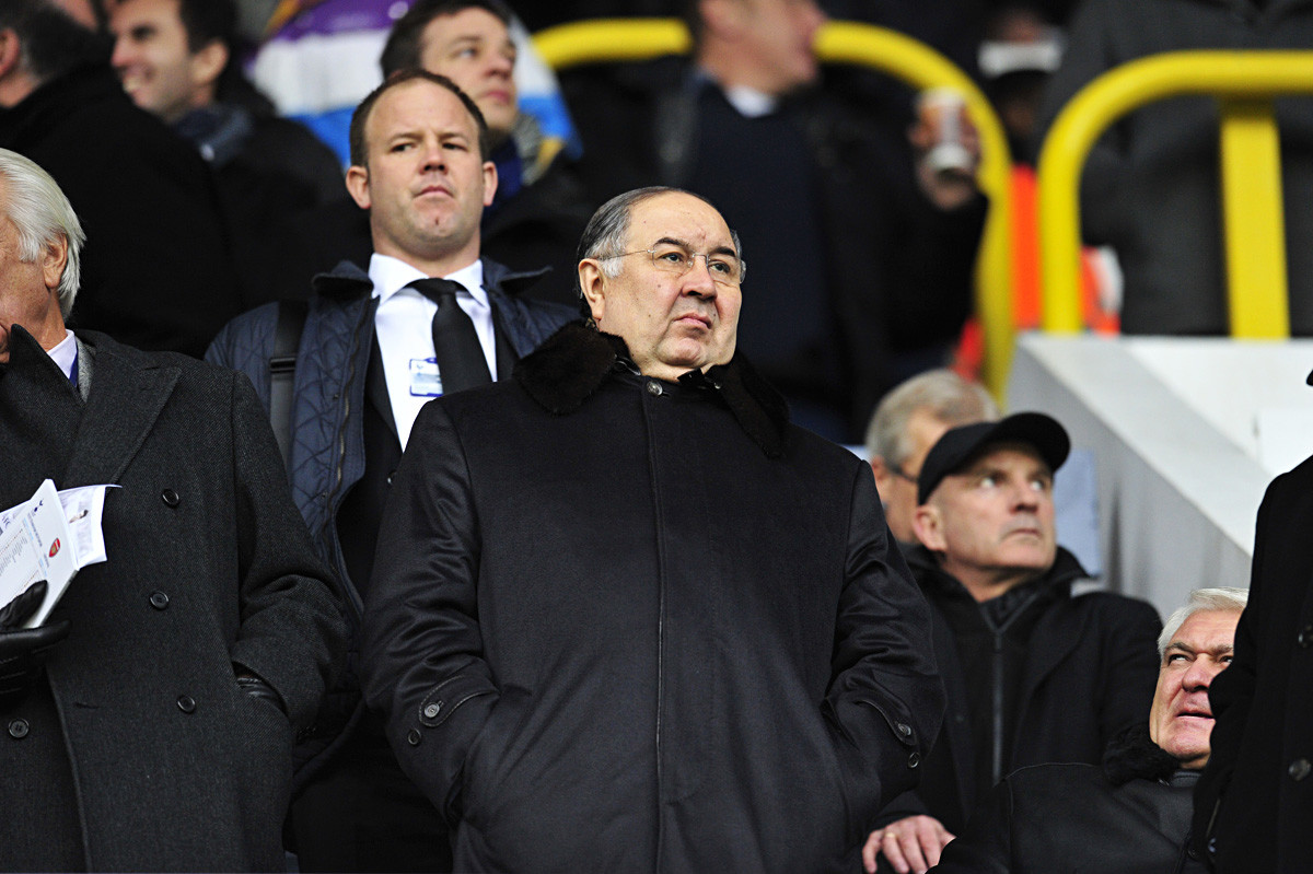 Alisher Usmanov watches the UEFA Champions League match between Arsenal and Bayern Munich in north London on February 19, 2013