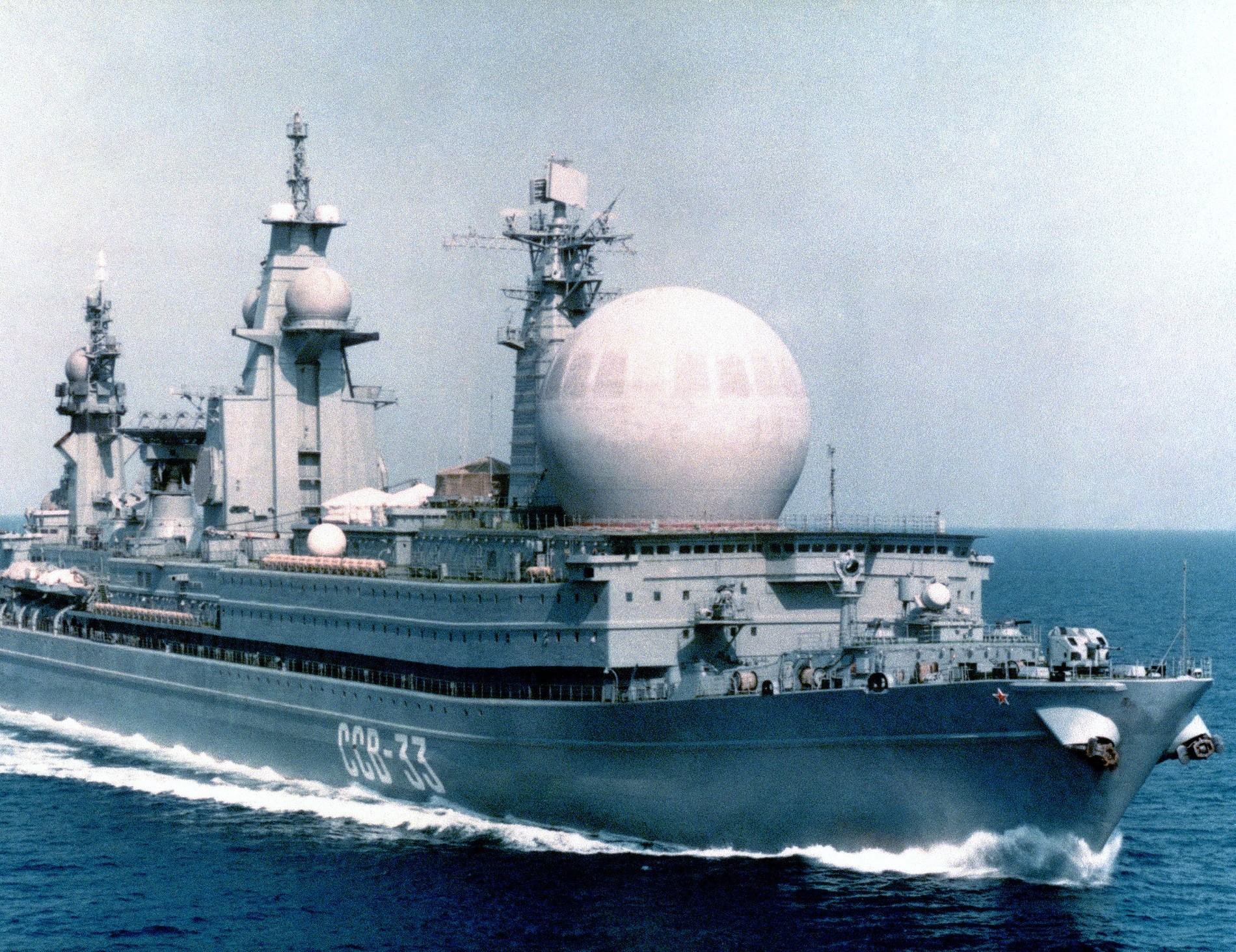 A starboard bow view of the Soviet naval auxiliary Kapusta Class Nuclear Powered Missile Range Ship SSV 33 underway.