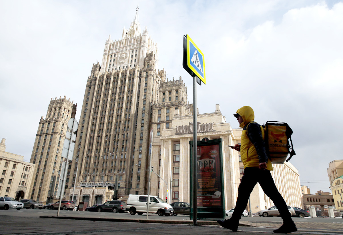 A food delivery service courier walks in front of the Russian Foreign Ministry headquarters in Moscow