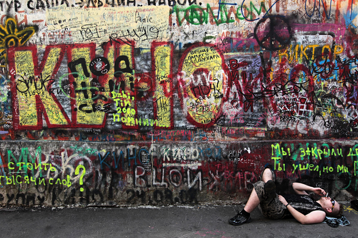 A guy taking a rest near Tsoi's Wall on Arbat Street, Moscow
