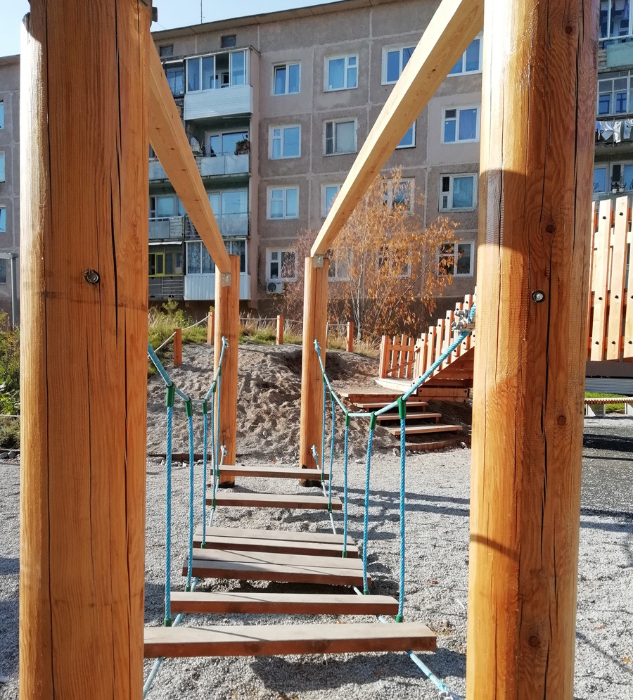 Wooden playground in the yard.