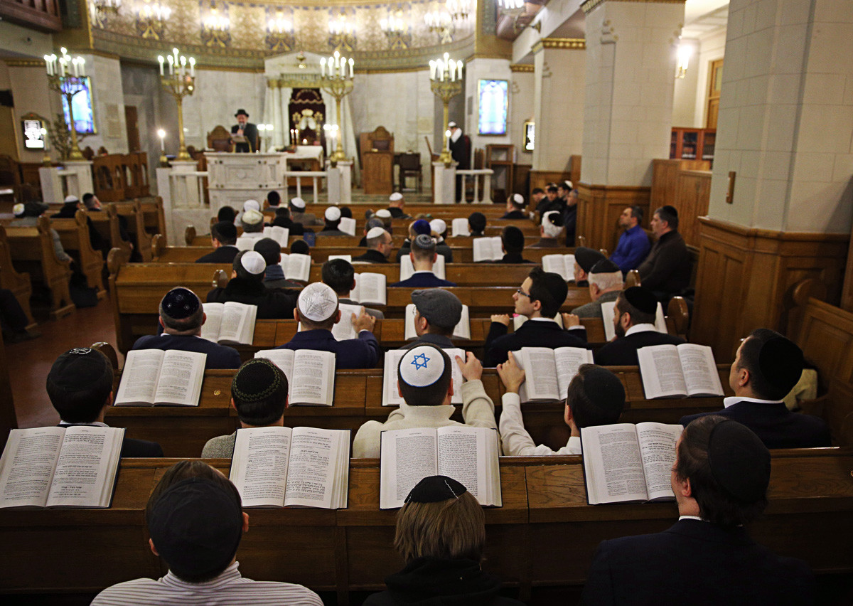 Jews read the Torah as they attend celebrations of the Passover at the Moscow Choral Synagogue in Bolshoi Spasogolenishchevsky Lane, 2018.