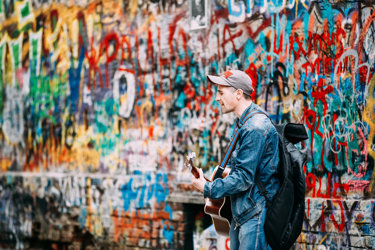 A street musician near Tsoi's Wall on Arbat Street, Moscow