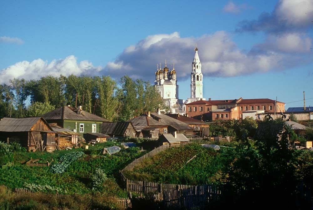 Trinity Cathedral & bell tower. Northwest view with wooden houses. August 26, 1999