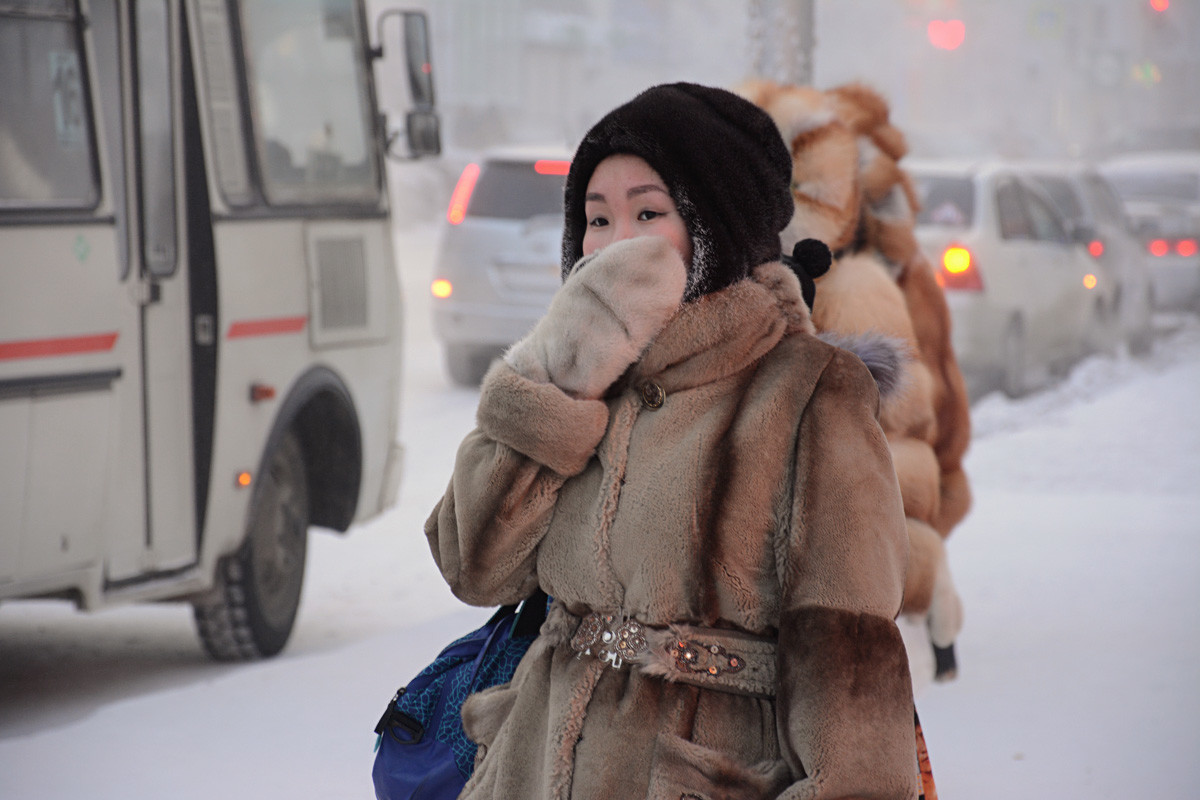 A young woman at a bus stop in Yakutsk.