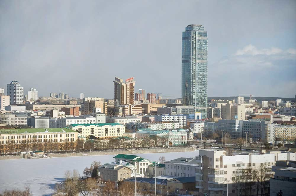 Yekaterinburg panorama. Center: Vysotsky Tower. Below: City Pond with Chapel of St. Catherine & Sevastyanov House (beneath tower). Lower left on pond: Back facade of residence of Urals Mining Director. April 1, 2017.