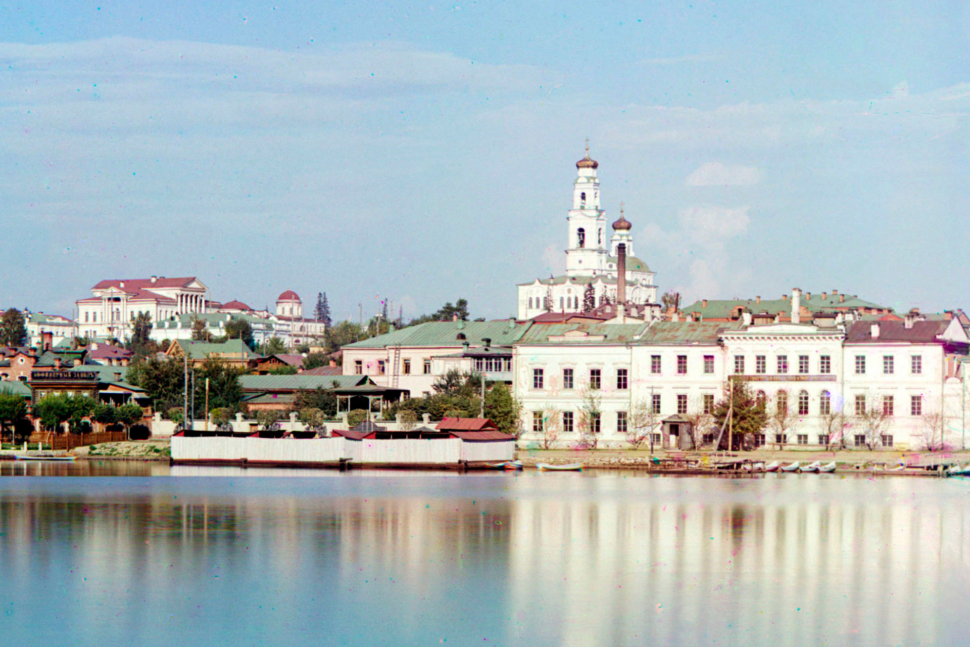 Yekaterinburg. View across City Pond toward Ascension Hill. From left:  Rastorguev-Kharitonov Mansion, Ipatyev house (partially visible beneath main portico of Kharitonov Mansion), bell tower & Church of Ascension. Summer 1909.