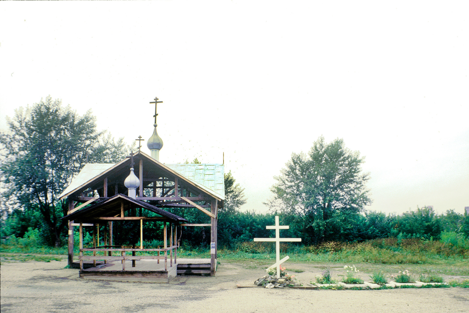 Cross & temporary chapel canopy on site of Ipatyev house (now site of Church of All Saints Resplendent in the Russian Land). August 25, 1999.