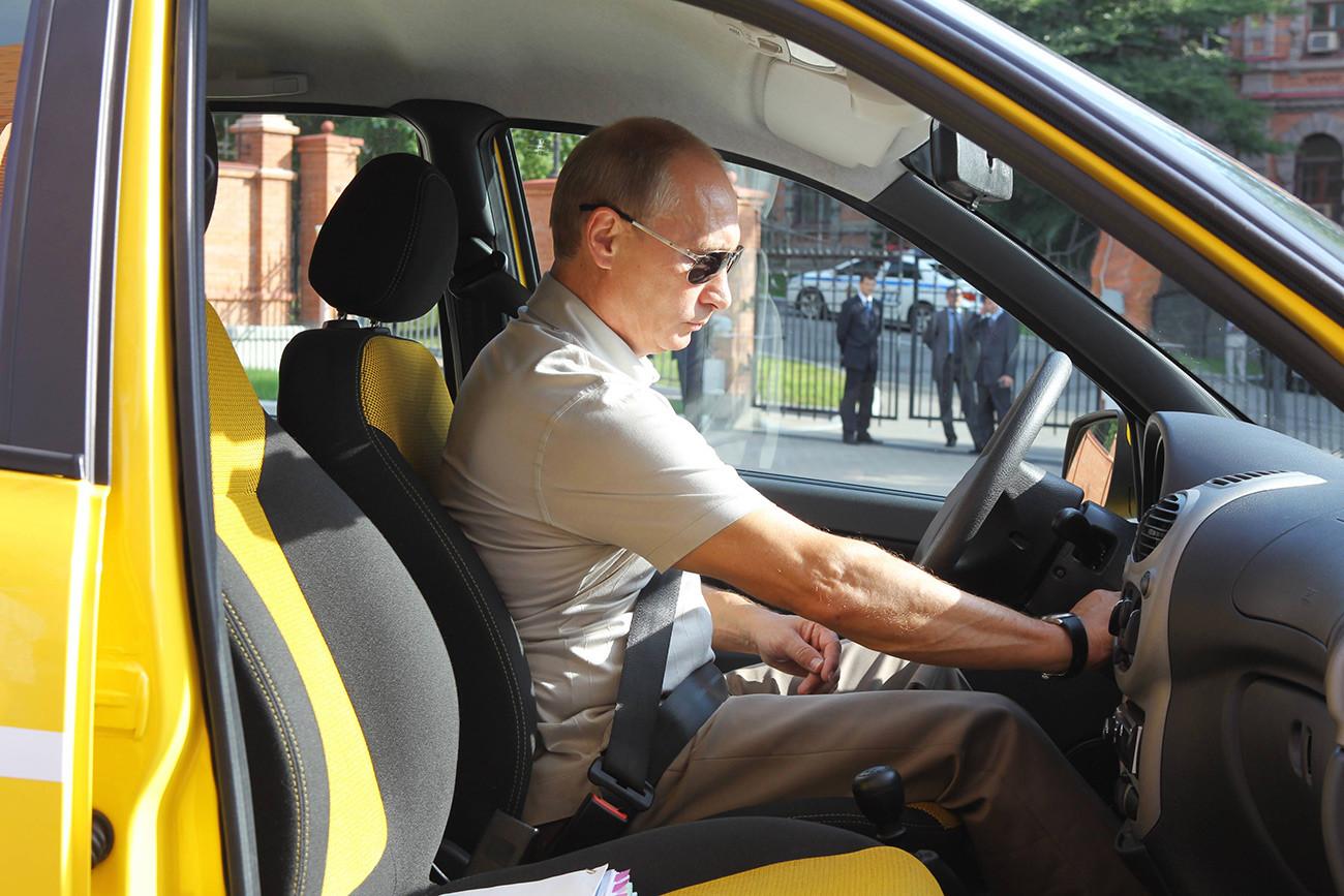 Vladimir Putin in a Lada Kalina