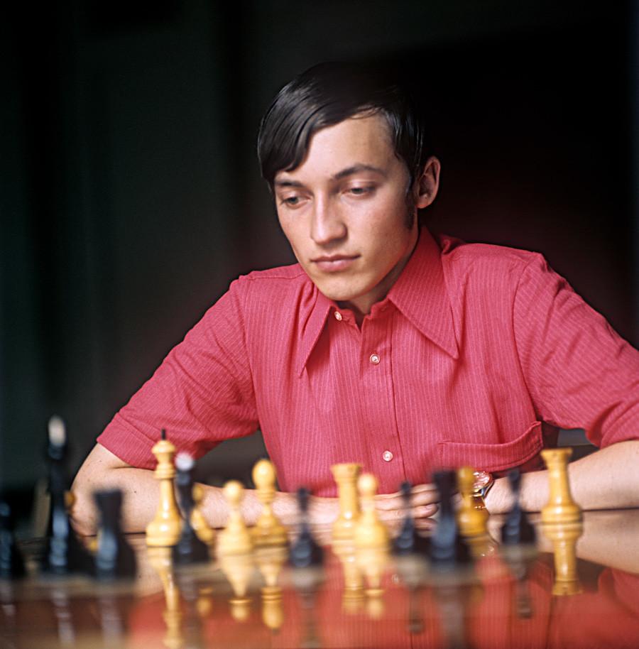 Grandmaster Anatoly Karpov playing a game of chess. 1974.