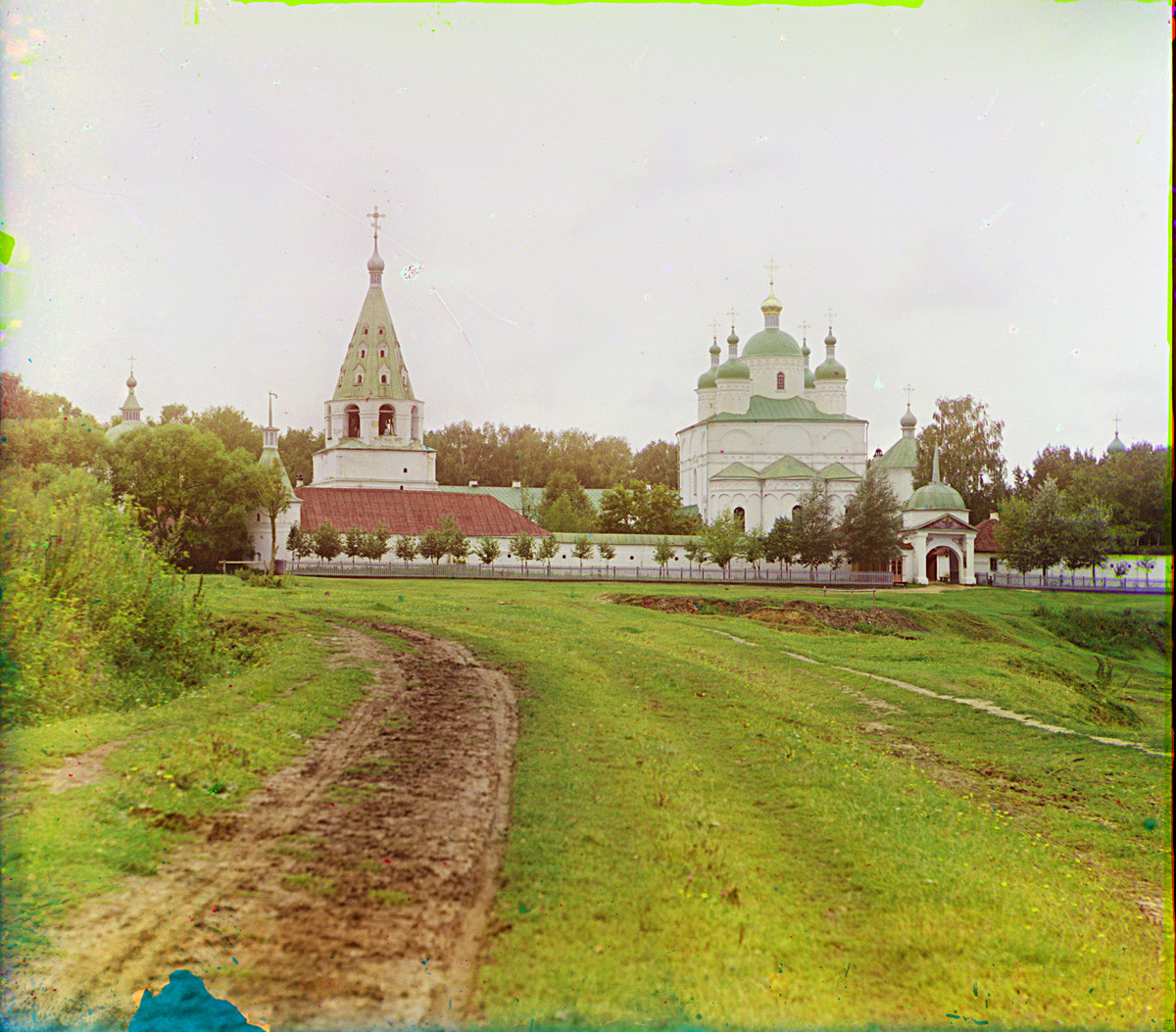 Luzhetsky-St. Ferapont-Nativity of the Virgin Monastery, east view. From left: Bell tower, Nativity Cathedral, Church of St. Ferapont (demolished), East Gate. Summer 1911.