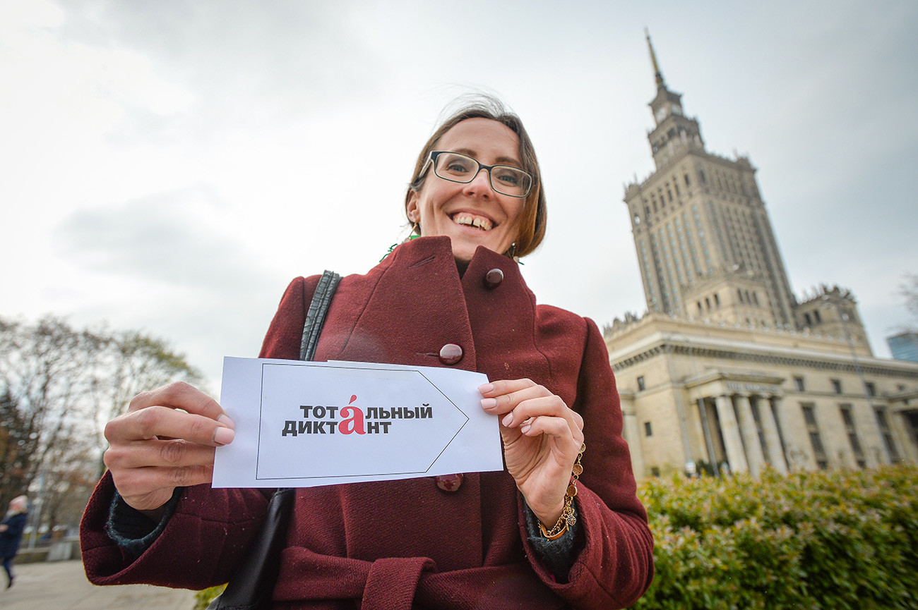 A woman participating in the Totalny Diktankt (Total Dictation) linguistic exercise in Warsaw, Poland.