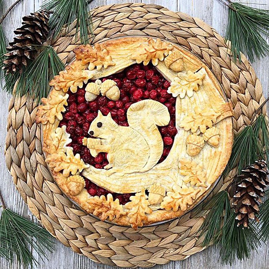 Cranberry pie with a squirrel and acorns.