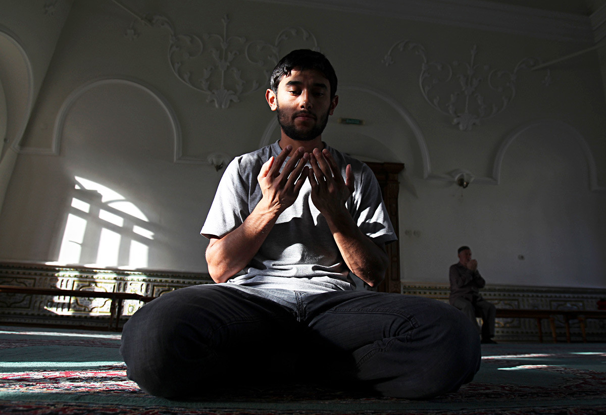 A man prays inside the Al-Marjani (also known as Marjani) mosque in Kazan.