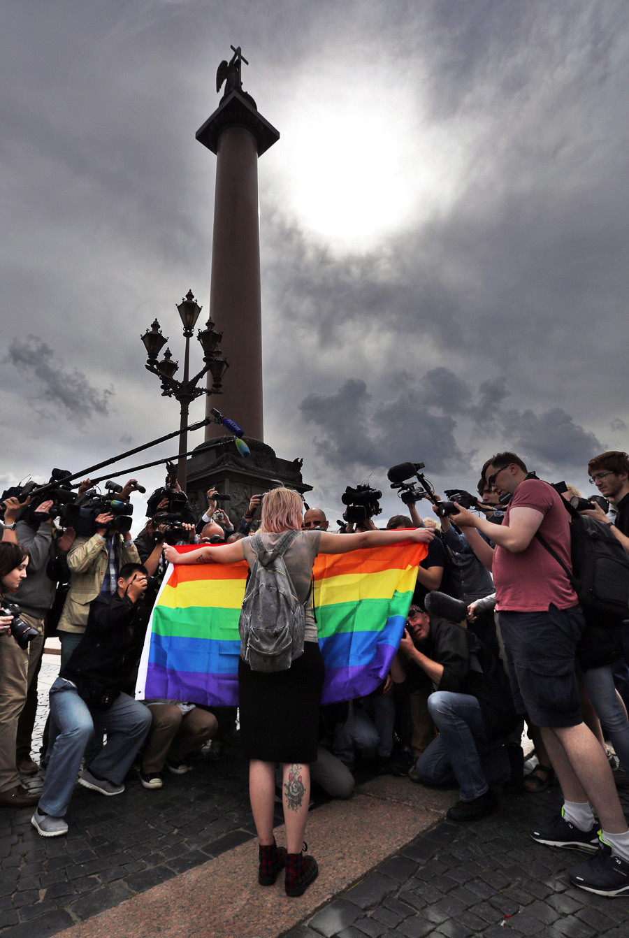 An LGBT activist stages a one-person protest against hatred and intolerance in St. Petersburg's Palace Square.