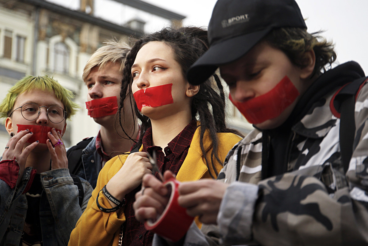 Activists of a local LGBT community putting tape over their mouths as they protest against discrimination in Saint Petersburg, Russia.