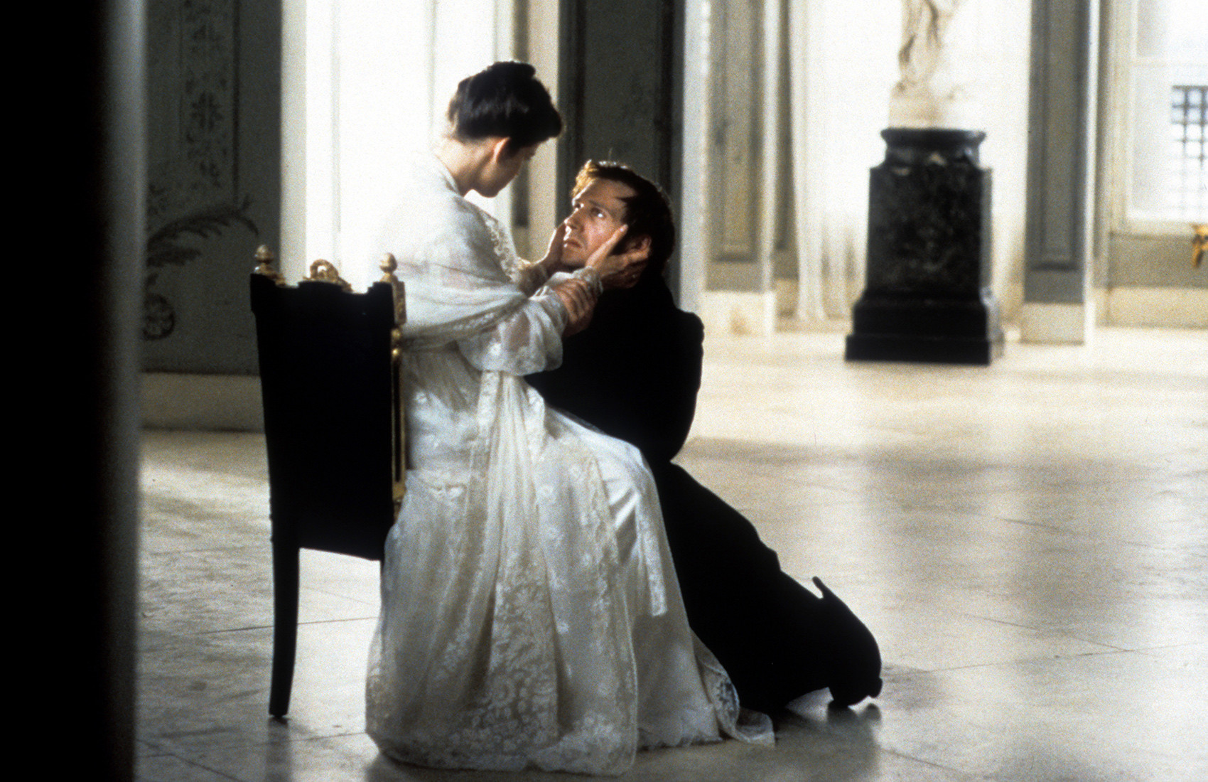 Ralph Fiennes as Eugene Onegin, on his knees.