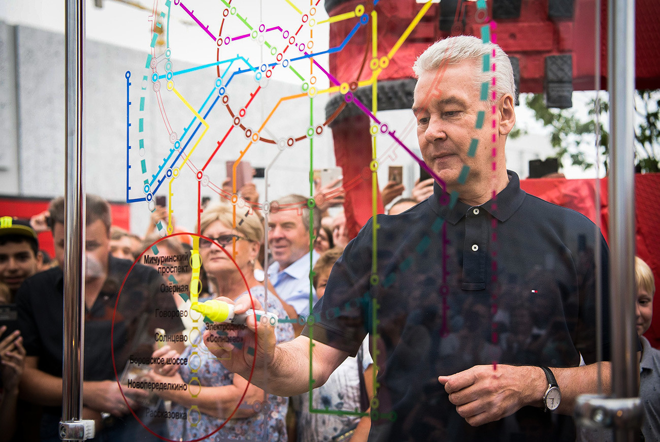 Sergey Sobyanin, the Mayor of Moscow, connecting the dots – he's drawing a line showing an additional part of one of Moscow Metro lines.