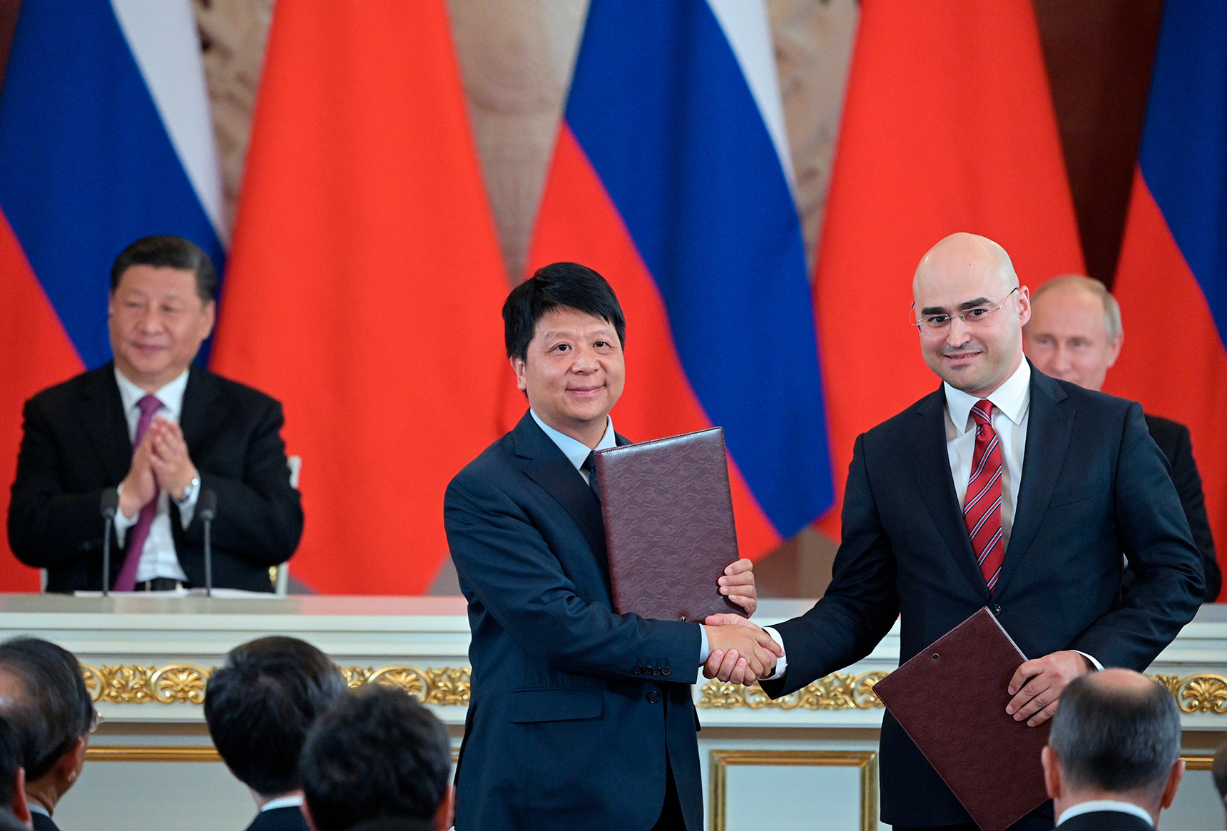 MTS PJSC President Alexey Kornya and Huawei CEO Guo Ping (right to left in the foreground) at the signing ceremony of joint documents on the results of Russian-Chinese negotiations
