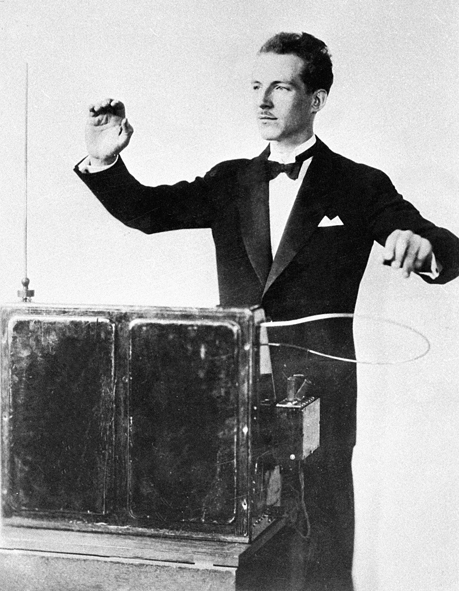 Theremin playing an electric musical instrument invented by him