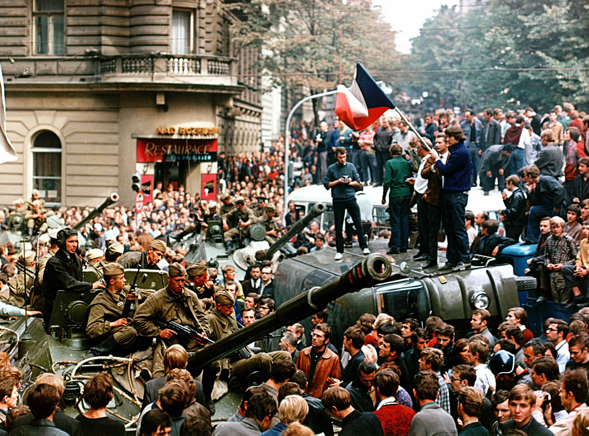 Soviet soldiers try to get to Prague headquarters of Czechoslovak Radio through streets packed by protesting people in August 1968.