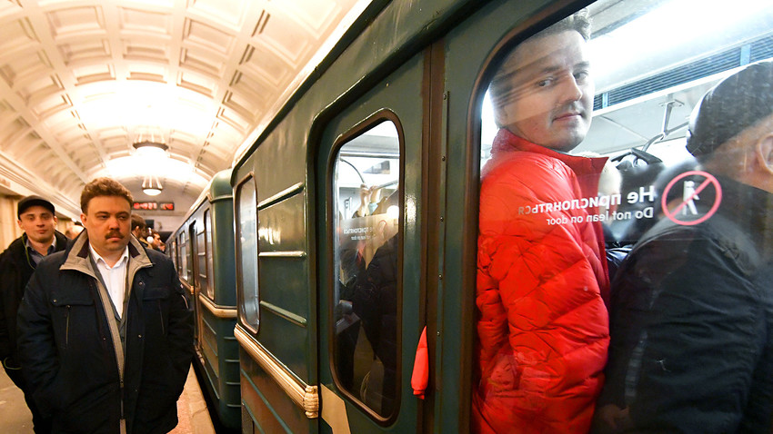 Russia, Moscow. Passengers at the Moscow's 'Teatralnaya' metro station during the rush hour.