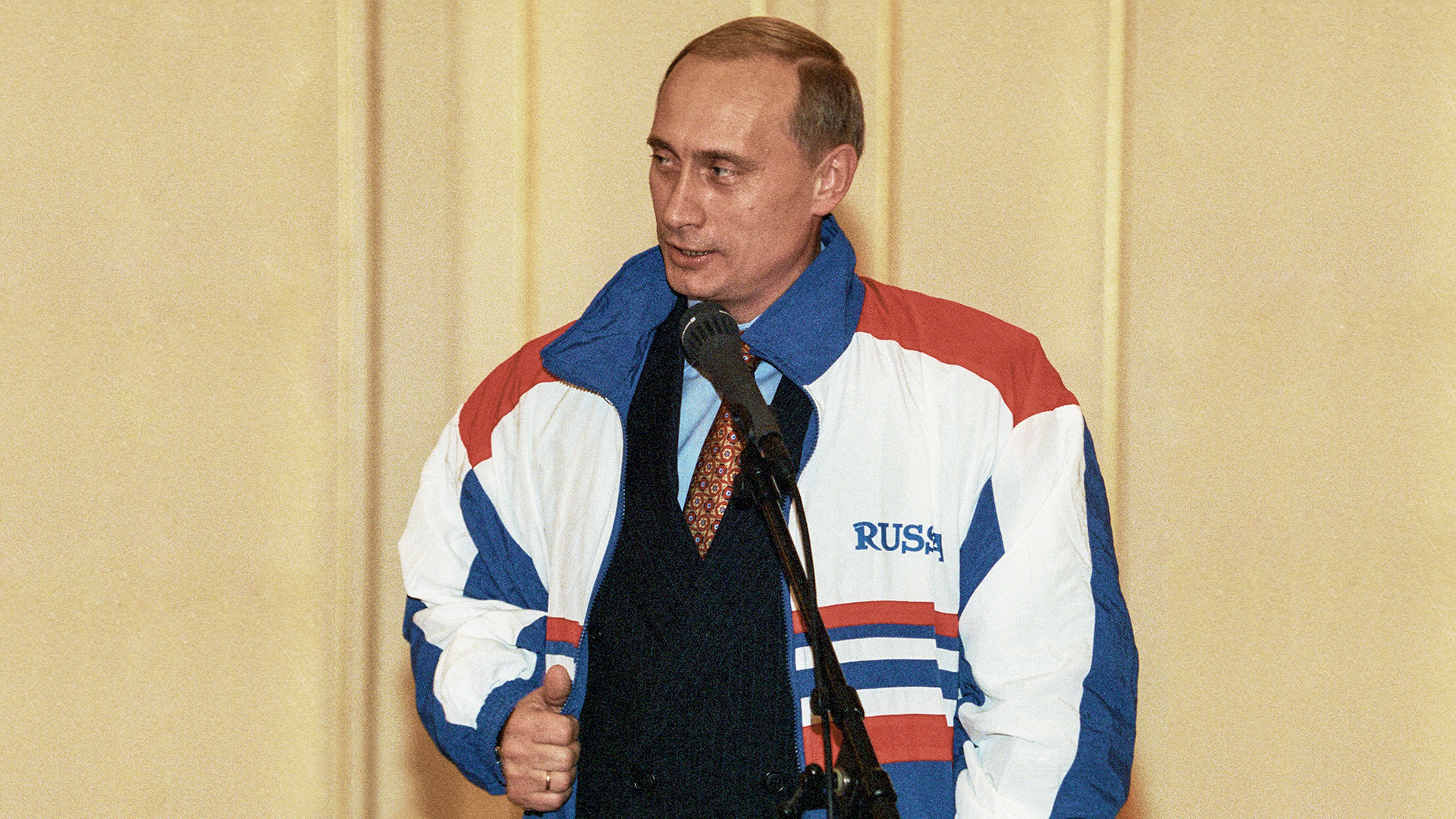 Russian Prime Minister Vladimir Putin speaks to athletes in front of the athletics team.