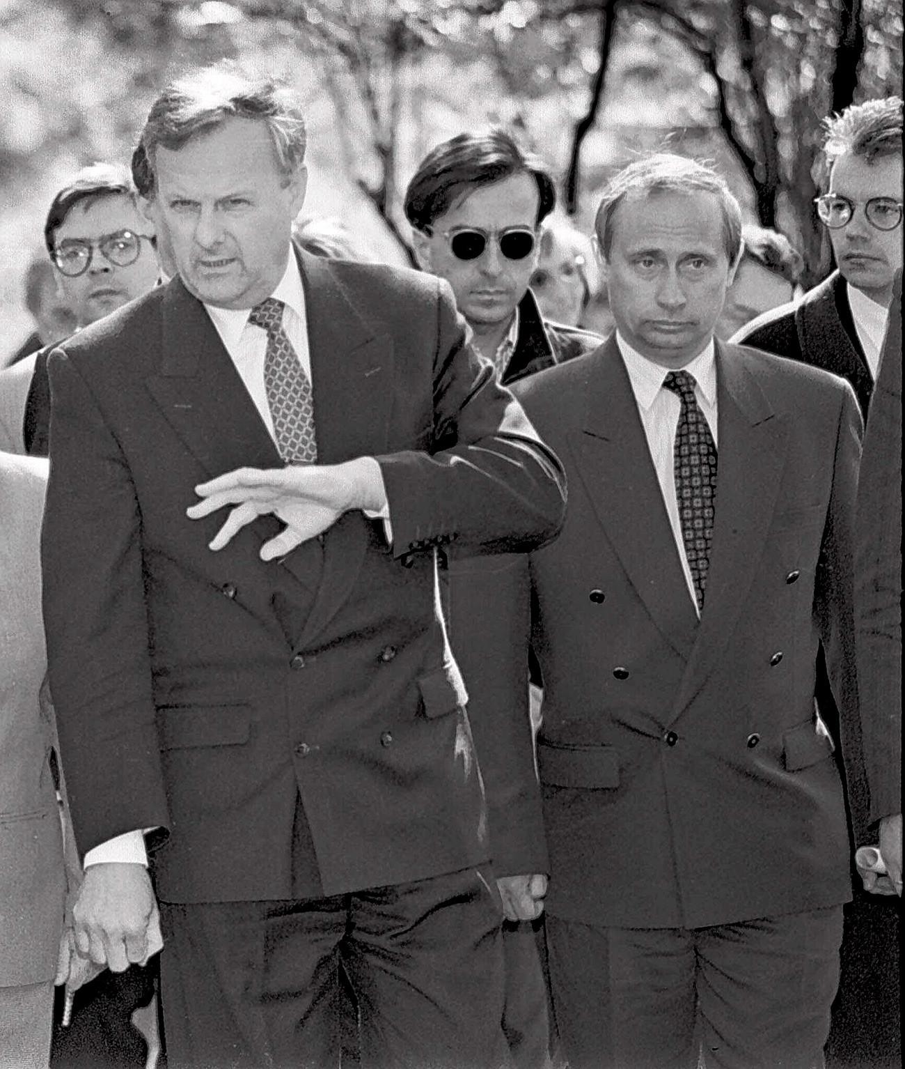 Anatoly Sobchak, mayor of St. Petersburg, gestures with Vladimir Putin, deputy mayor in St. Petersburg in 1994.
