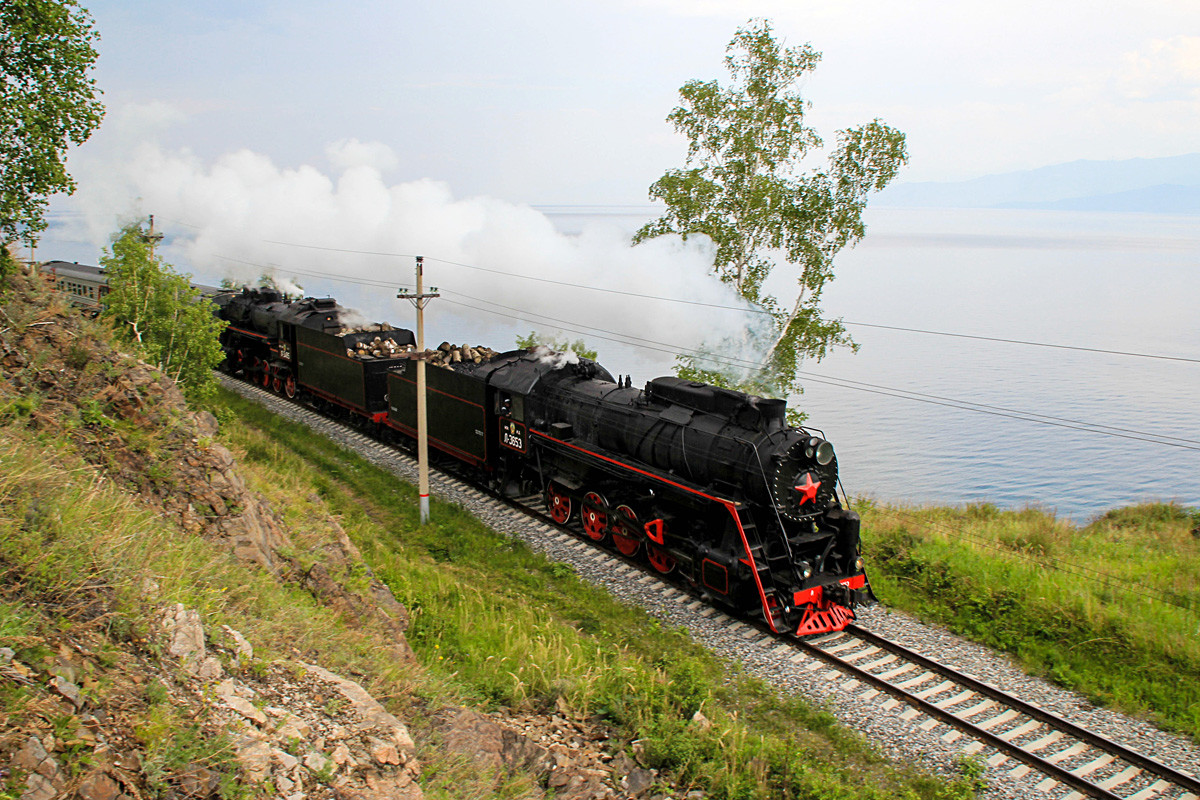A steam engine of a tour train rides on the Circum-Baikal railway, a part of the East Siberian Railway along the shores of Lake Baikal.