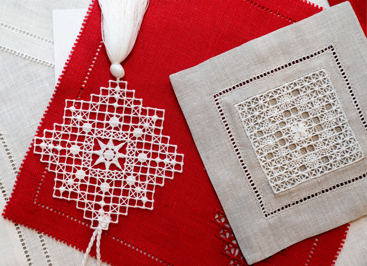 NOVGOROD REGION, RUSSIA - JANUARY 24, 2019: Linen products of the Kresttsy Stitch clothing factory reviving and implementing the Kresttsy stitchery, a traditional local embroidery technique dating from the 1860s, in the village of Kresttsy, Novgorod Region