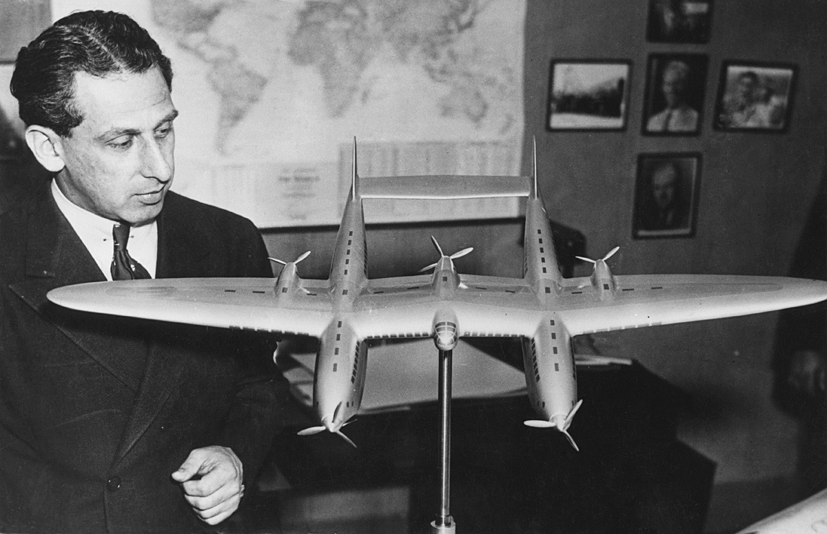 Alexander Prokofiev de Seversky with a model of a twin-fuselage aircraft, circa 1935.