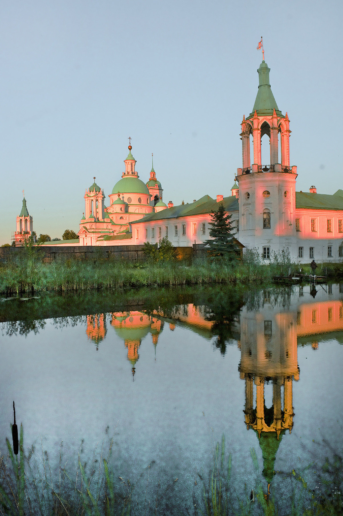 North wall, northwest view across monastery pond.  From left: Northeast corner tower, North Gate, Church of St. Dimitry of Rostov, cloisters & northwest corner tower. July 7, 2019.