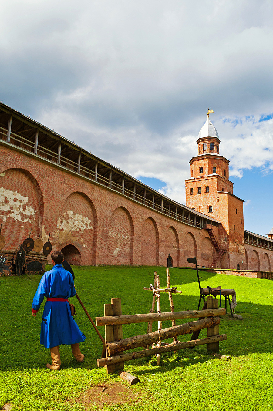 Kokui tower of Veliky Novgorod Kremlin and man dressed in medieval clothes in Veliky Novgorod, Russia.