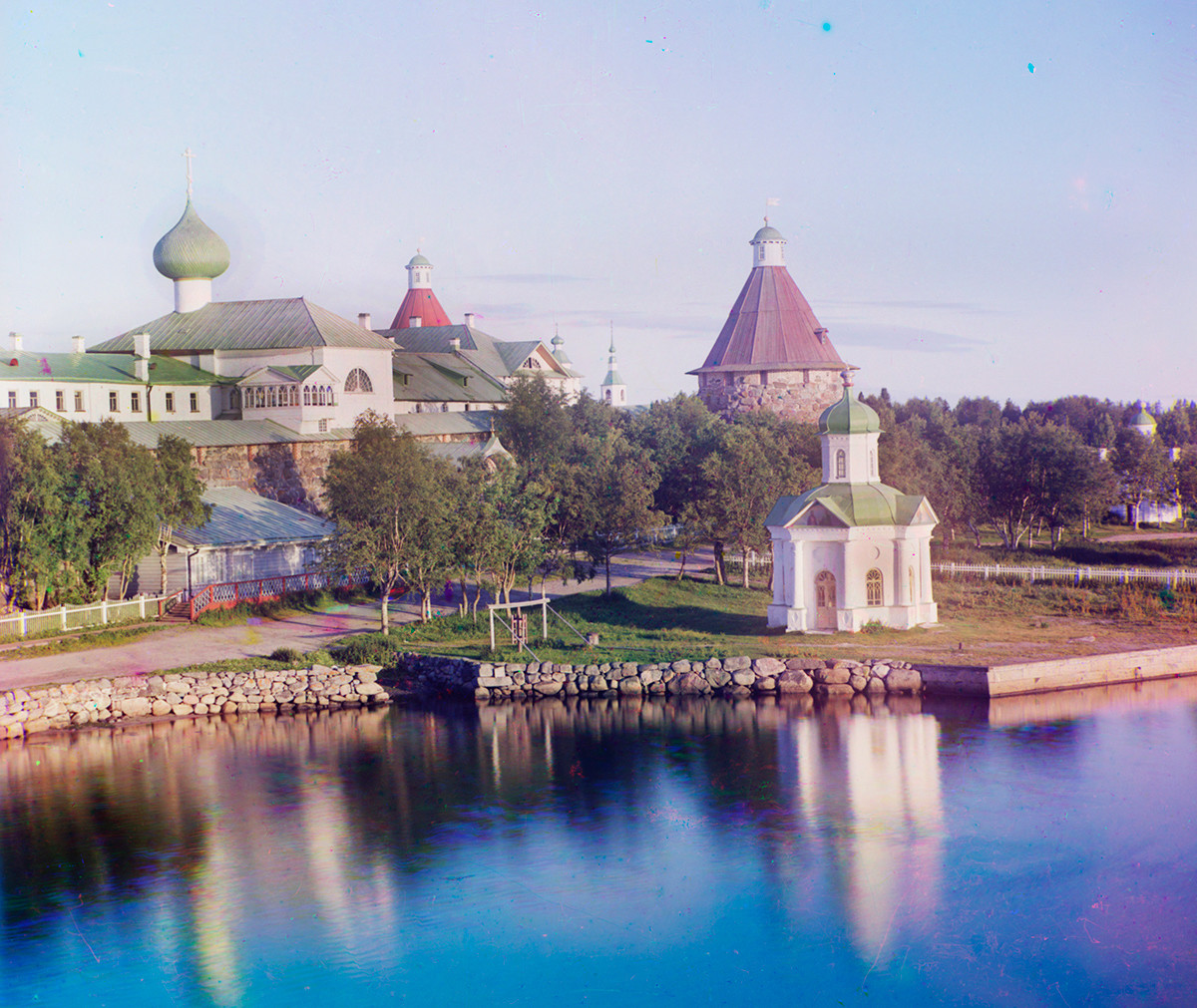 Transfiguration Monastery. Northwest view from Preobrazhensky Hotel dock. From left:  Annunciation Church over Holy Gate, Chapel of Saint Alexander Nevsky. Late summer 1916