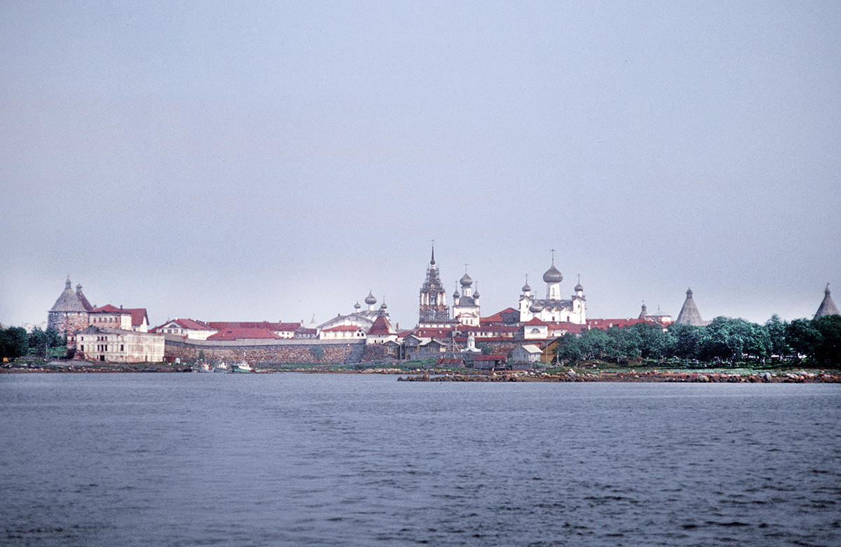 Transfiguration Monastery. West panorama from Solovetsky Bay. Center: Bell tower, Church of St. Nicholas, Transfiguration Cathedral. Left foreground: Preobrazhensky Hotel & dock.  June 29, 1999