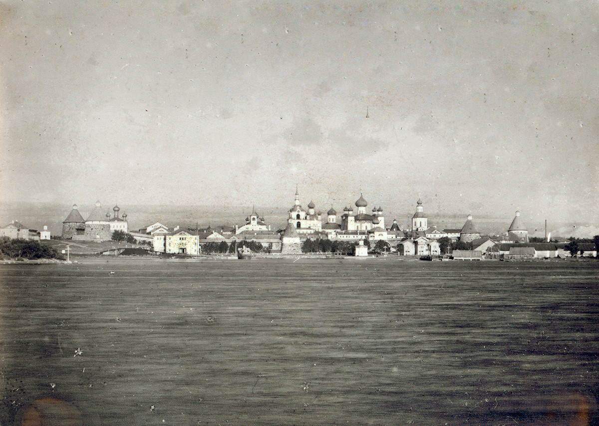 Transfiguration Monastery. West panorama across Solovetsky Bay. Center: Bell tower, Church of St. Nicholas, Transfiguration Cathedral. Left foreground: Preobrazhensky Hotel & dock.  Late summer 1916