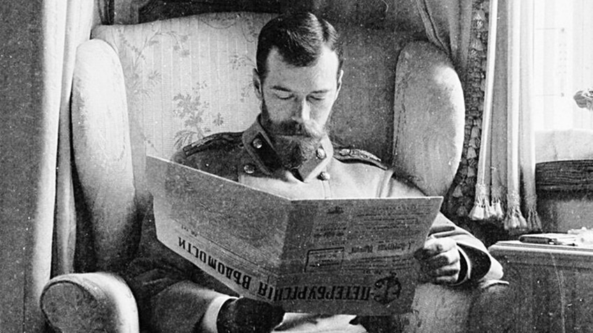 Nicholas II reading a newspaper in his palace at Tsarskoye Selo, 1902.