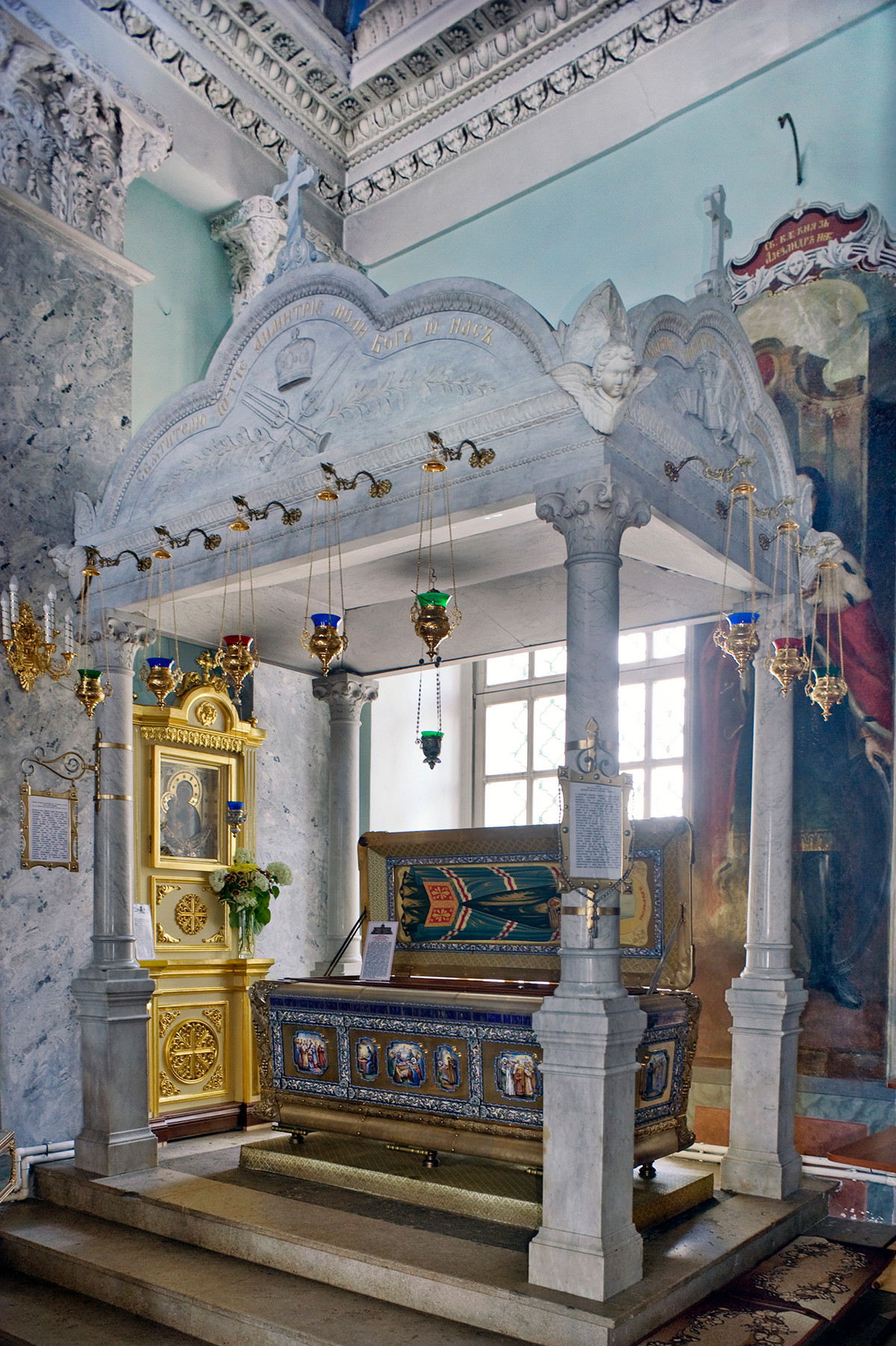 St. Dimitry Cathedral interior. Baldachin with silver sarcophagus  (third) containing relics of St. Dimitry of Rostov. July 7, 2019