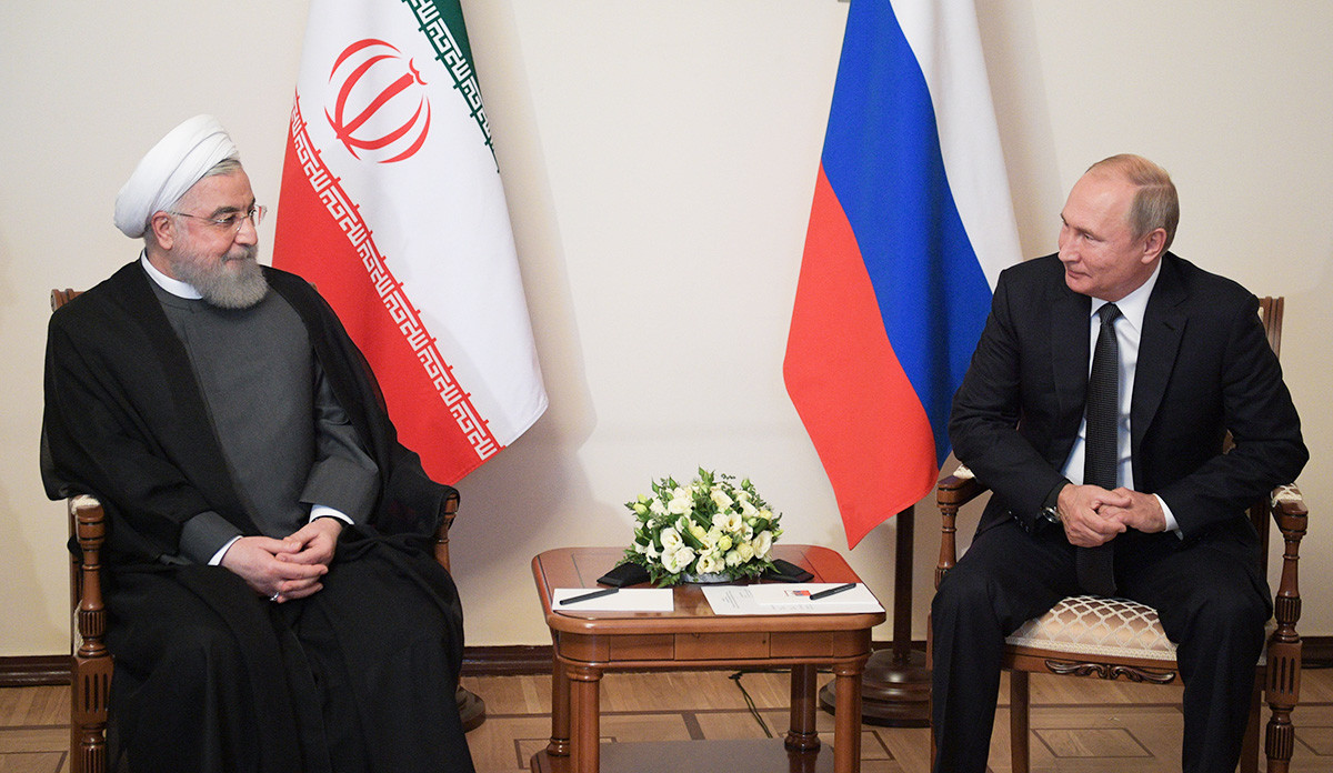Russian President Vladimir Putin speaks with Iranian President Hassan Rouhani during a meeting of the Supreme Eurasian Economic Council in Yerevan on October 1, 2019.