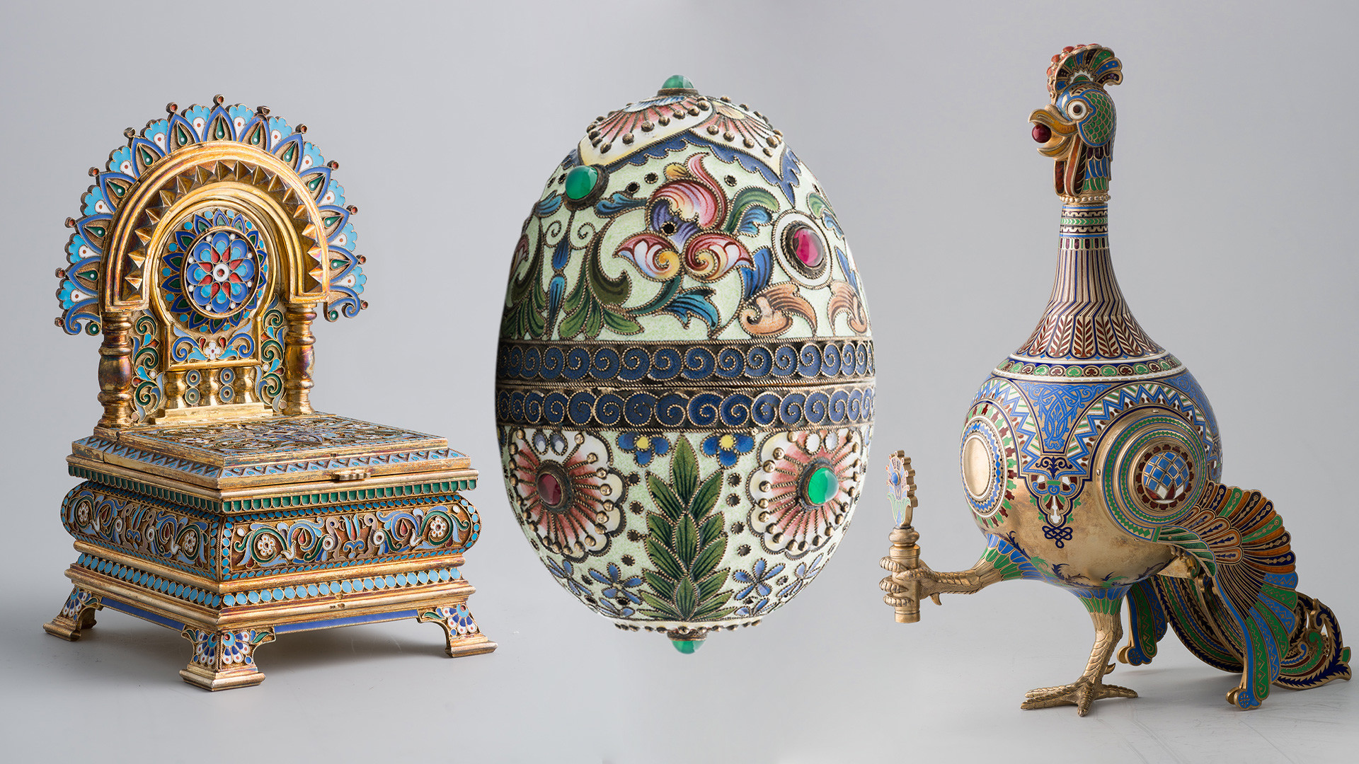 L-R:. Salt shaker. The House of Fabergé; Easter egg. Rückert's firm; Cockerel' carafe. I.P. Khlebnikov's firm