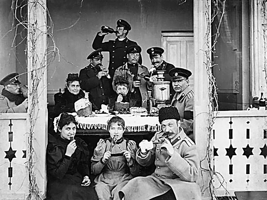 At the dacha's festive table, 1910s.
