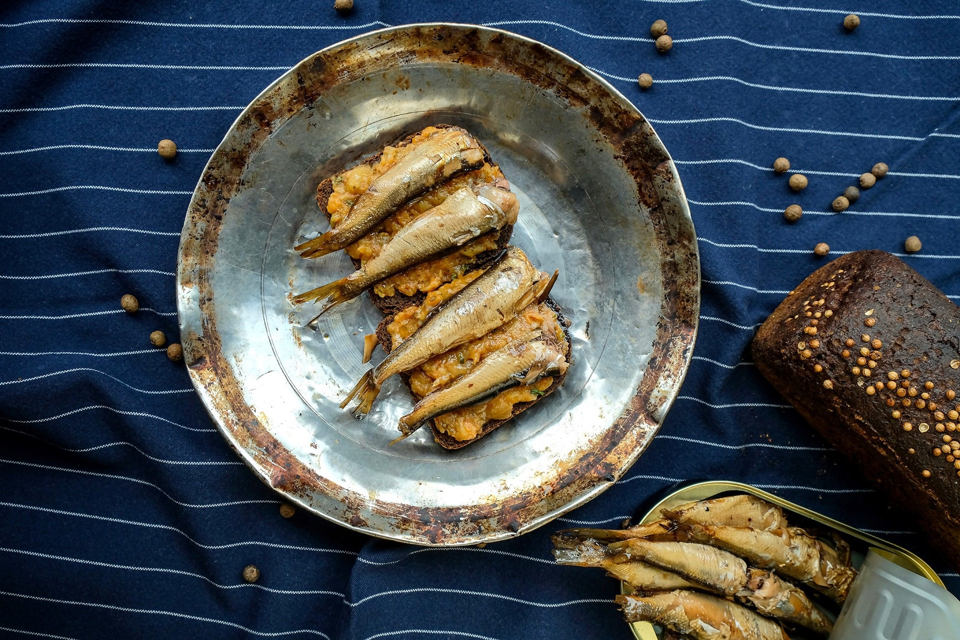 Sandwiches with sprats, salty and oily