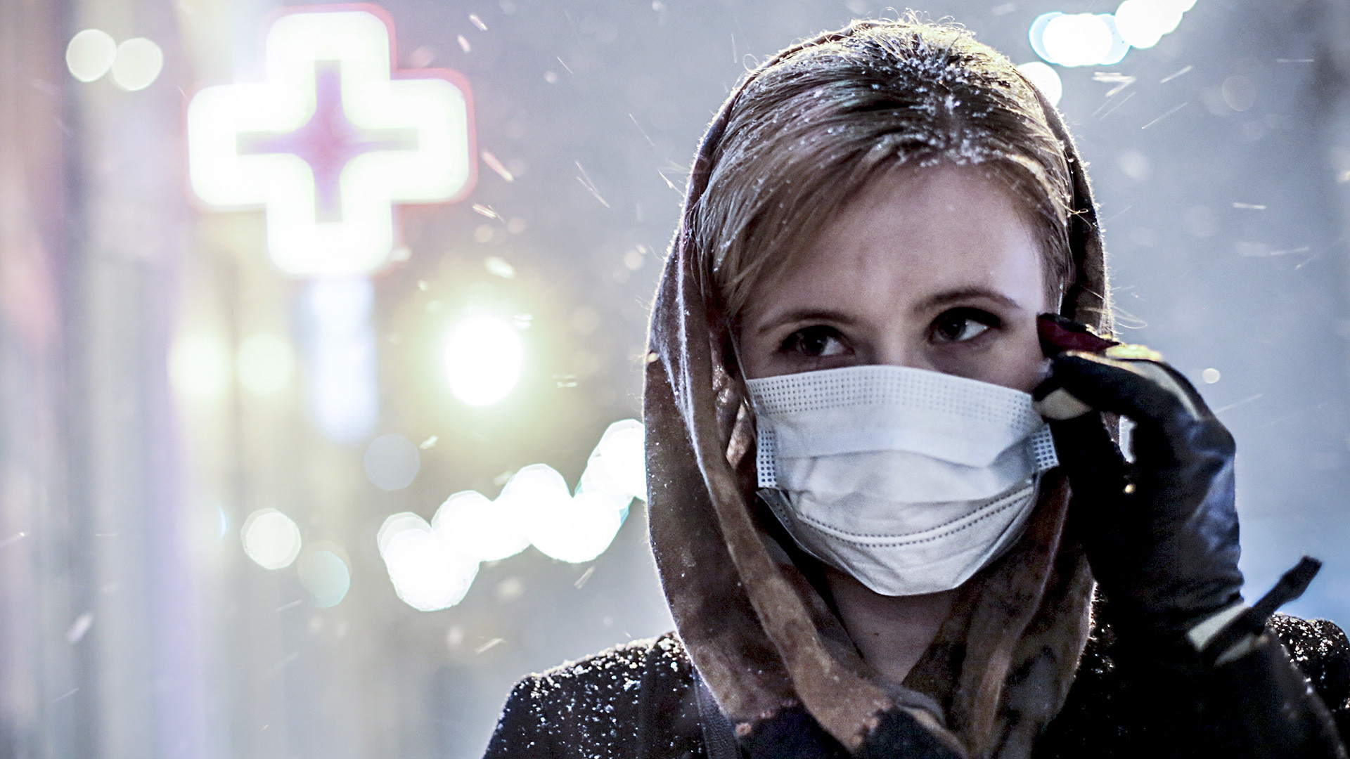 Russia. Novosibirsk. January 28. A girl in a medical mask on one of the streets of the city.
