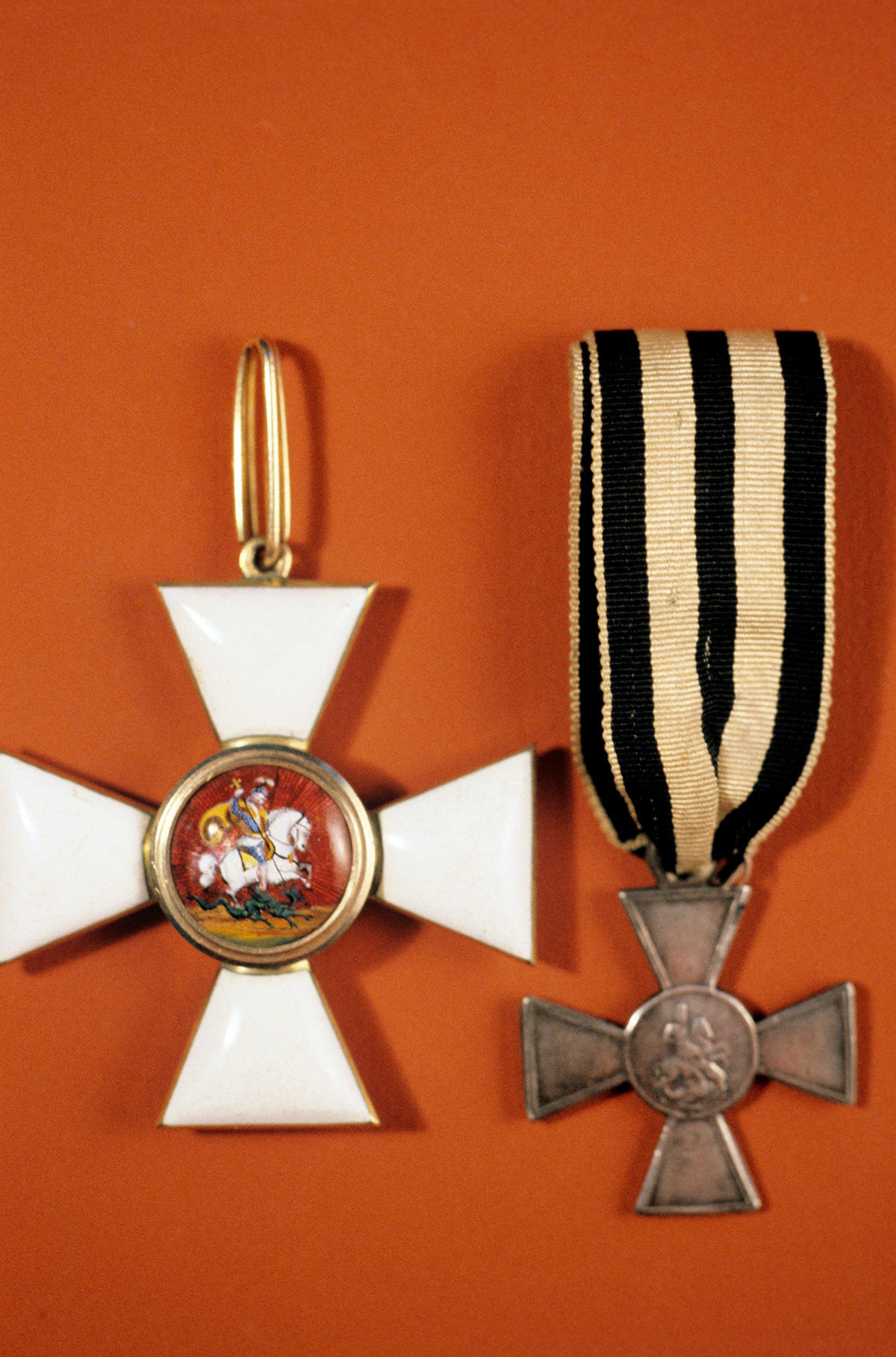 The Cross (badge) (L) of the Order of St. George, and the iron Cross of St. George (R), decoration of the Order meant for soldiers