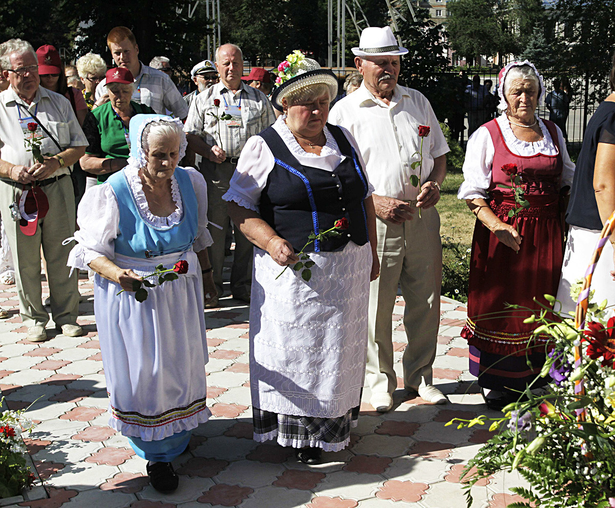 July 19, 2013, Saratov region, Russia. The 250th-anniversary celebrations of the publication of Manifesto of Empress Catherine II 'On inviting foreign settlers'. Placing the flowers at the monument to 'Russian Germans who were victims of repression in the USSR'.