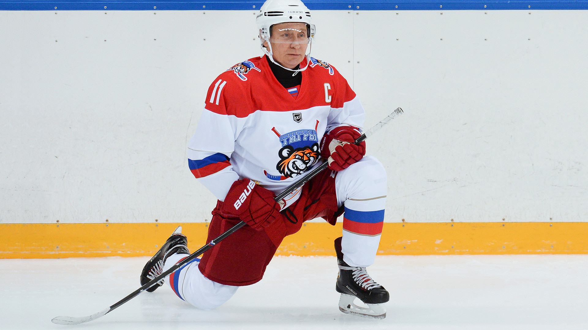 President Vladimir Putin warms up before an ice hockey match, Sochi, 2019