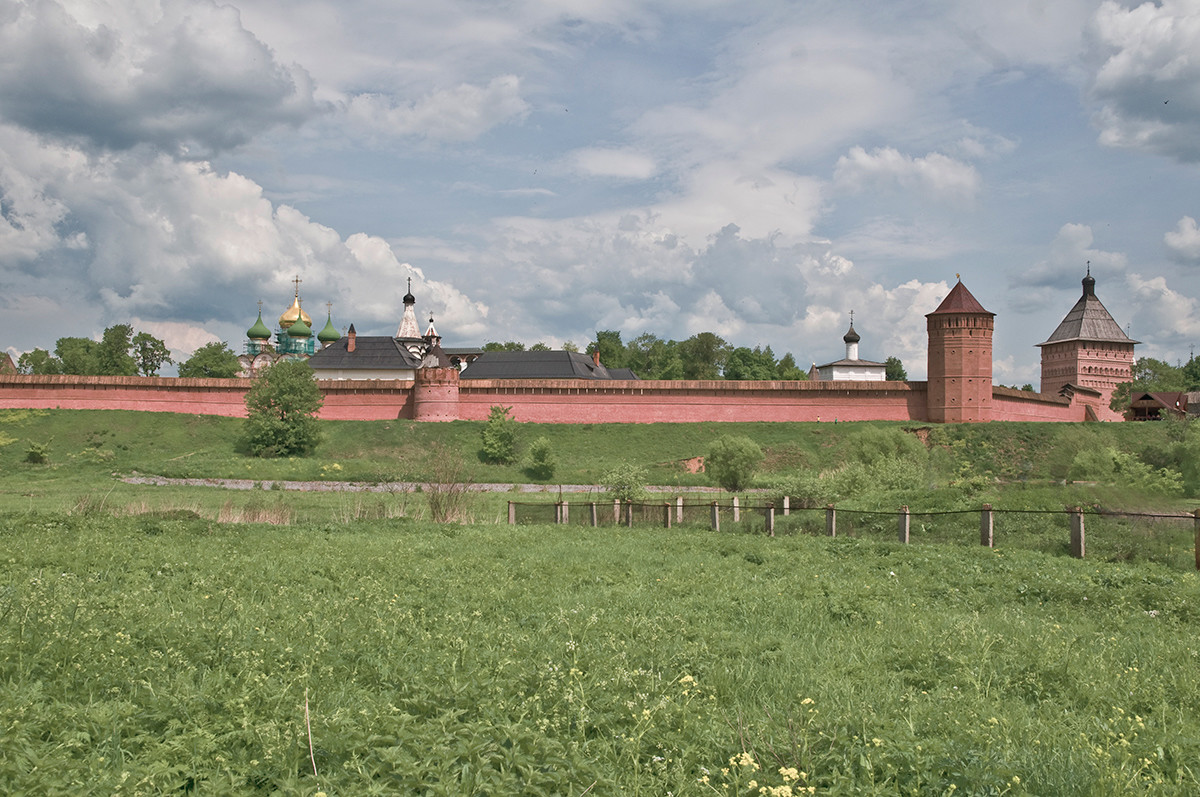 Suzdal. Savior-St. Evfimy Monastery, west view across Kamenka River. Left center: cupolas of Transfiguration Cathedral, Church of the Intercession. May 29, 2009