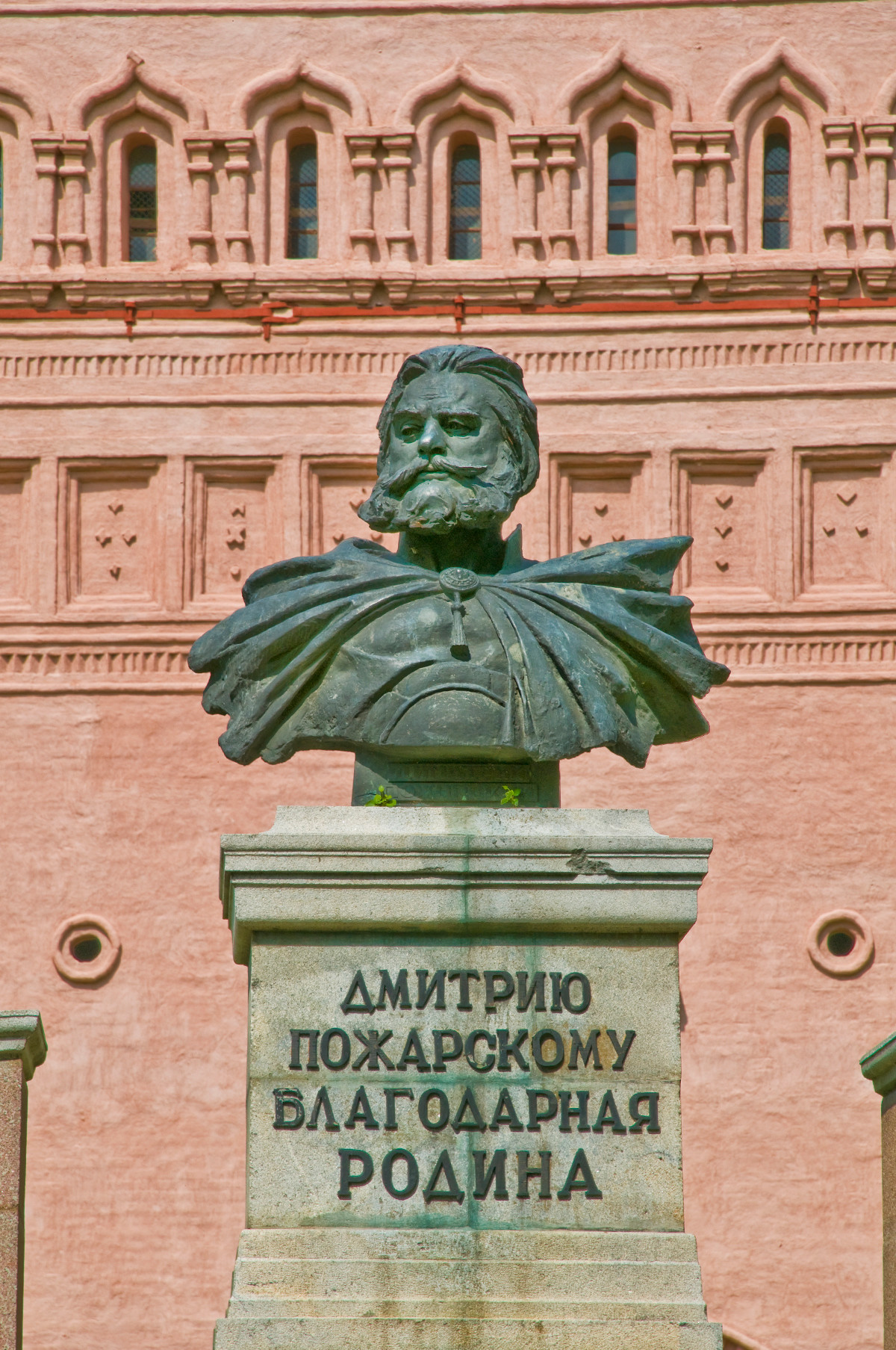 Monument to Prince Dmitry Pozharsky. Background: Main entrance tower of Savior-St. Evfimy Monastery. May 29, 2009