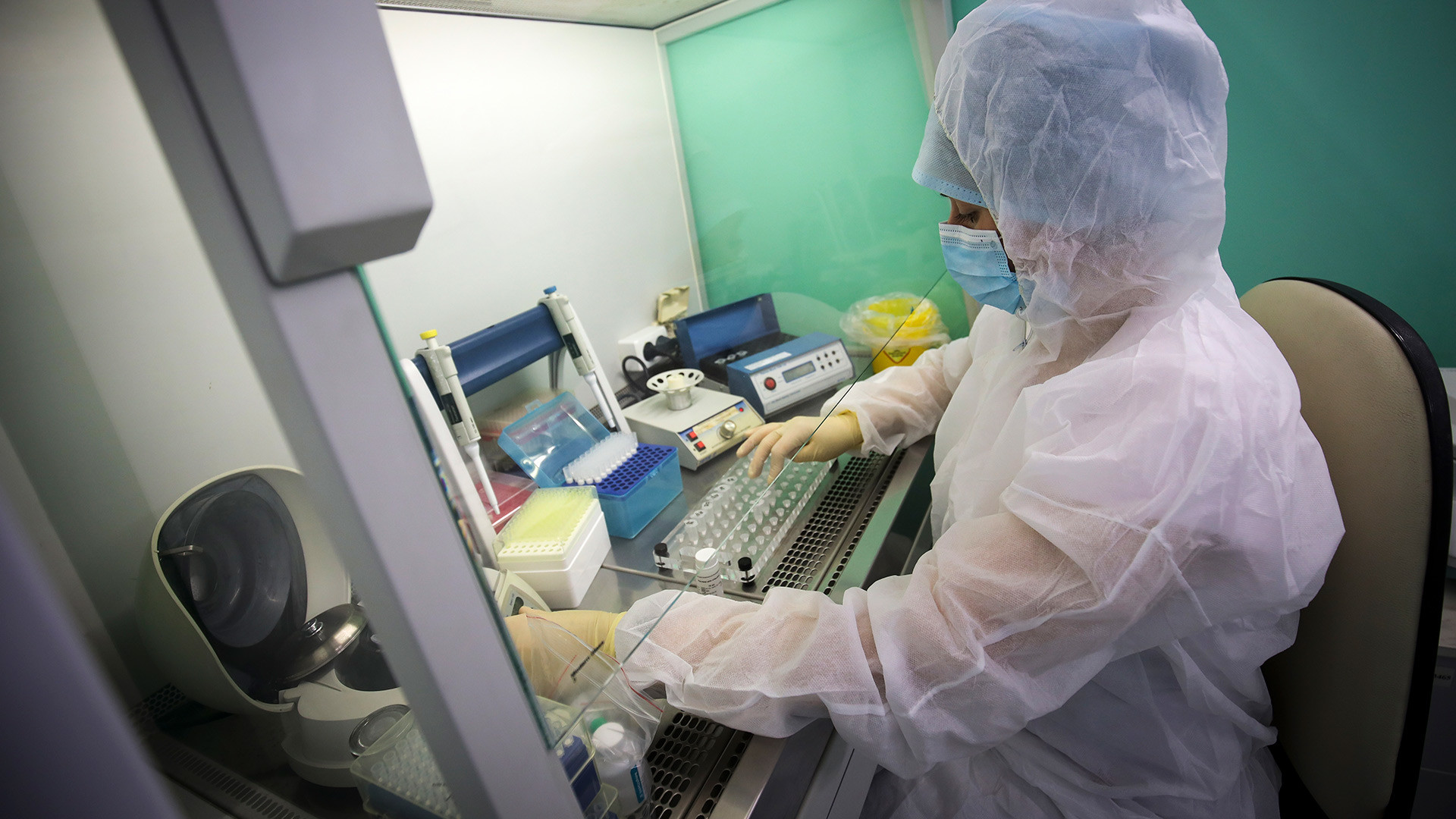 A medical staffer works with test systems for the diagnosis of coronavirus, at the Krasnodar Center for Hygiene and Epidemiology microbiology lab in Krasnodar, Russia