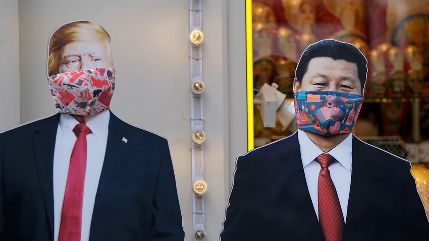 Cardboard cutouts of U.S. President Donald Trump and Chinese President Xi Jinping near a gift shop in Moscow.